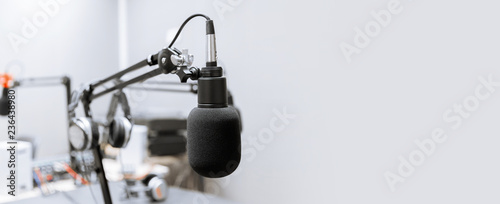 Canvastavla  technology and audio equipment concept - microphone at recording studio or radio