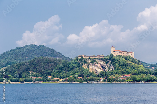 Fotografering  View of the fortress Rocca of Angera, as seen across Lake Maggiore