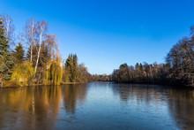 Partially Frozen Pond In Winter. End Of Autumn. Austria.