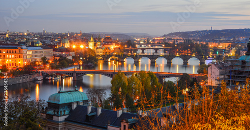 Poster Prague View of bridges on Vltava River at night