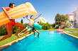 canvas print picture - Funny teens with swim tools jumping into the pool