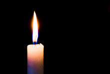 A  Candle Burns Brightly On A Black, Isolated Background. Free Space For Text_