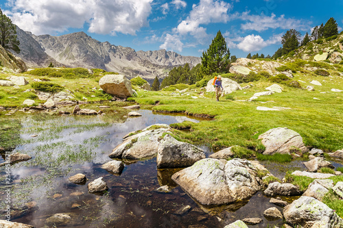 Impressive view of Pyrenees landscape in Andorra, with woman hiker Canvas Print