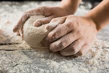 Male Chef Hands Knead Dough Wi...