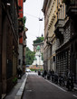 a narrow street in the center of Milan that comes out in front of the Castello Sforzesco