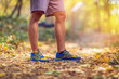 Running sport fitness man. Close up of male legs and shoes. Man athlete fitness runner running shoes. Trail running concept..