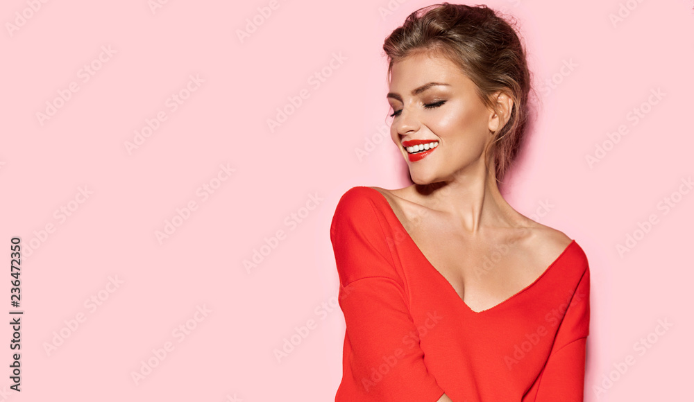 Fototapeta Portrait of young stunning model with bright impressive red lips. Studio photo shoot of pretty woman in fashionable sweater. Modern fashion and youth concept