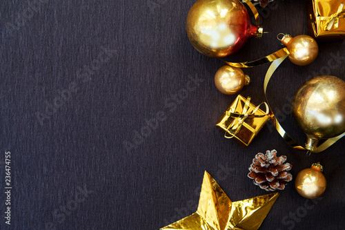 Fototapeta Happy New Year's layout. Christmas decorations, Christmas toys, gold stars, gifts. Goals for the new year, flatlay obraz na płótnie