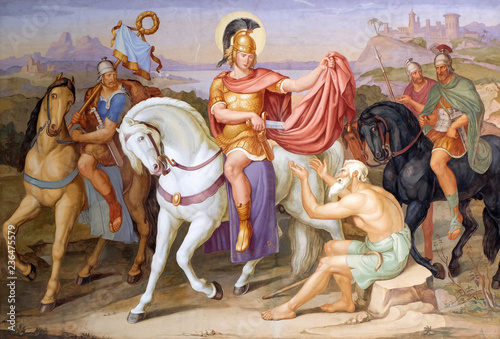 Saint Martin of Tours cuting a piece of his cloak for a beggar, fresco in the Saint Martin church in Unteressendorf, Germany
