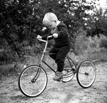 Young Boy On The Bicycle