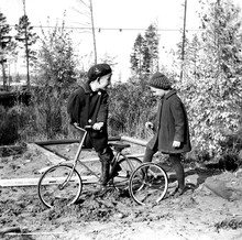 Boy And Girl With Bicycle Outdoors