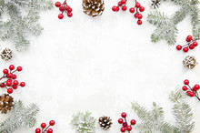 Christmas Creative Frame Made Of Cones, Red Berry And Fir Branches On White Background With Free Space For Lettering. Winter Concept. Flat Lay. Top View.