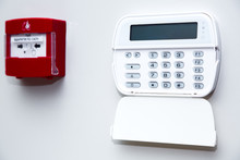 Alarm Control Panel And Fire Button On A Light Gray Wall, Close-up Of The Security Password Entry System To Activate And Set The Alarm.