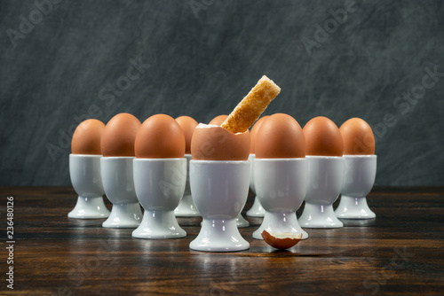 Toast Soldier Dipped Into Boiled Egg in Egg Cup on a Table