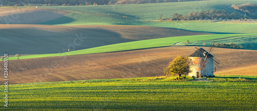 Panorama landscape with waves hills, autumn fields with mill. South Moravia