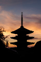 Low Angle View Of Silhouette Buddhist Temple Against Cloudy Sky During Sunset