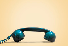 Blue Vintage Telephone On Beige Background