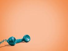 Vintage Telephone On Orange Ba...