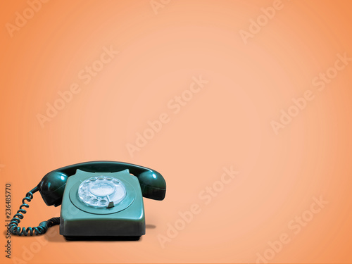 Vintage telephone against orange background