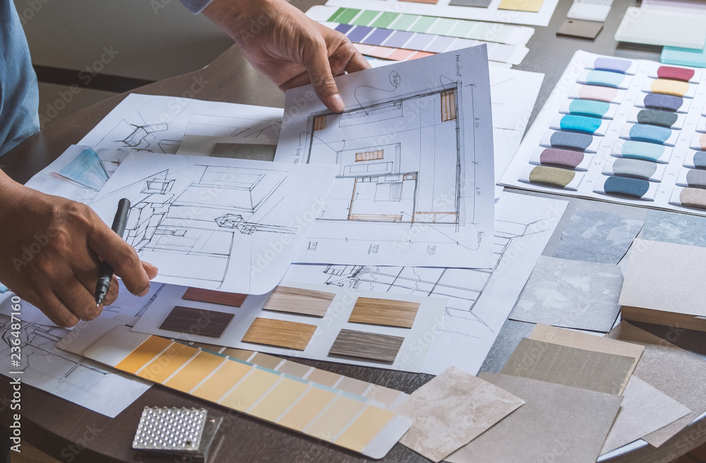 Fototapeta Architect designer Interior creative working hand drawing sketch plan blue print selection material color samples art tools Design Studio