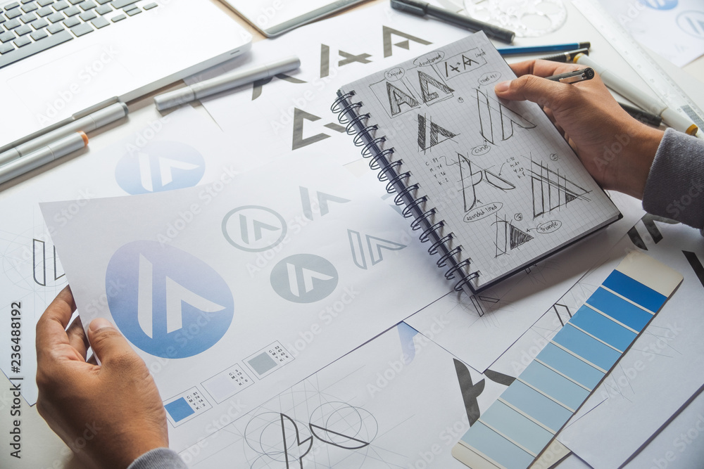Fototapety, obrazy: Graphic designer development process drawing sketch design creative Ideas draft Logo product trademark label brand artwork. Graphic designer studio Concept.