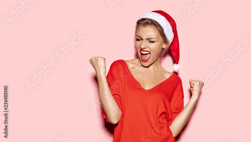 Portrait of happy and excited young girl looking stylish in christmas festive outfit Tablou Canvas