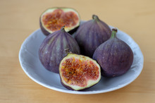 Common Fig Ficus Carica Ripened Violet Fruits, Group Of Figs On Small White Plate On Wooden Table