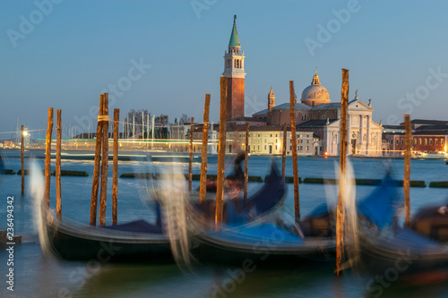 Spoed Foto op Canvas Gondolas gondolas in Venice, in the background it can be seen the church of San Giorgio maggiore