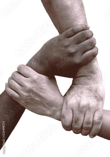 Fotografía  Three different races hands holding together.