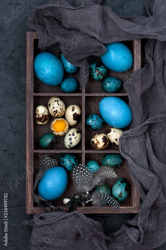 Easter colorful eggs in decorative wooden box, top view