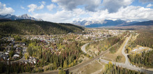 Aerial Panoramic View Of Residential Homes In A Small Alpine Town During A Cloudy Day. Taken In Jasper, Alberta, Canada.