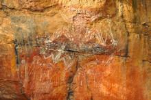 Aboriginal Rock Art Of People Dancing At Kakadu National Park, Northern Territory, Australia.