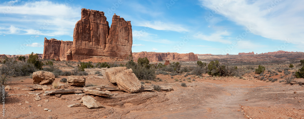 Fototapety, obrazy: Panoramic landscape view of beautiful red rock canyon formations during a vibrant sunny day. Taken in Arches National Park, located near Moab, Utah, United States.