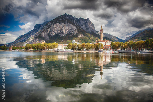 Valokuva City of Lecco reflected in the waters of Lake Como on a beautiful summer day