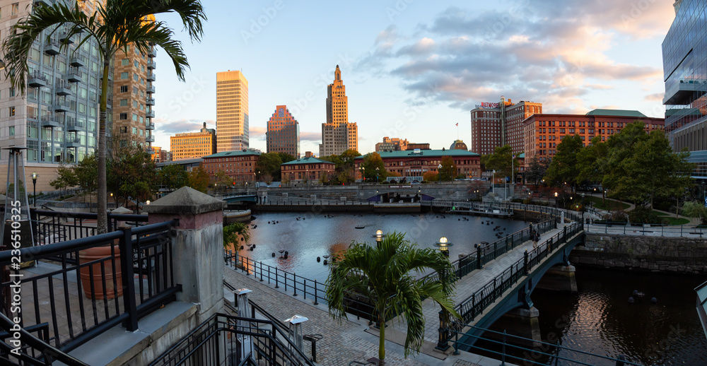 Fototapety, obrazy: Downtown Providence, Rhode Island, United States - October 25, 2018: Panoramic view of a modern cityscape during a vibrant sunset.