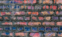 Multi Coloured Old Brick Wall