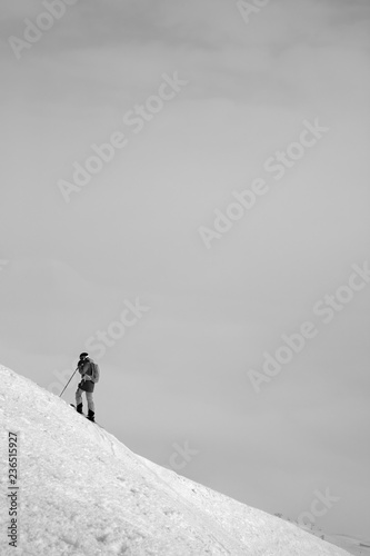 Skier before downhill on snowy freeriding slope