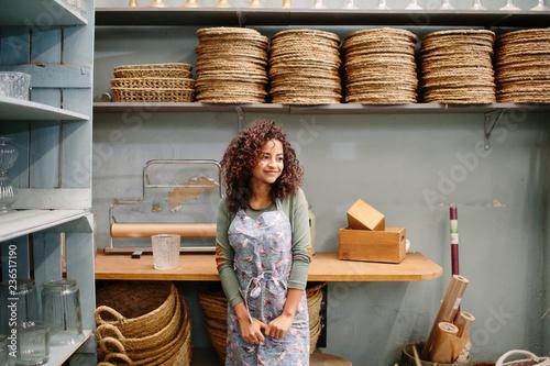 Adorable woman posing in shop storage Fototapeta