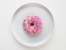 Classic Donut With Pink Frosting And Colorful Sprinkles