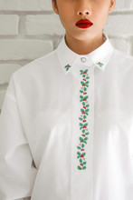 Red Lips Woman Portrait In White Christmas Embroidered Shirt