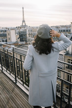 Young Woman On A Balcony With ...