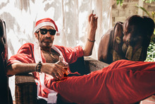 Man Resting In Santa Dress