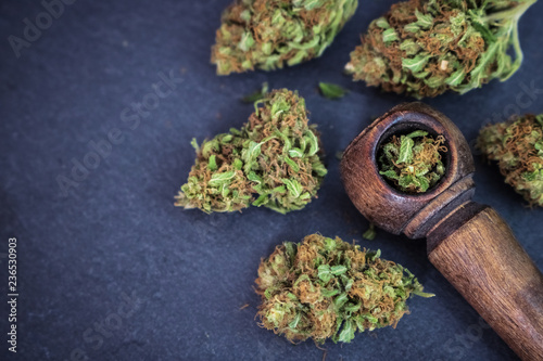 Photo  Marijuana flower with wooden pipe