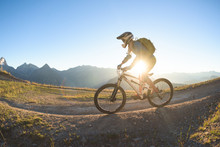 Woman Riding Mountain Bike On Staggering Backcountry Route