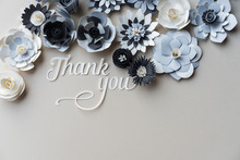 Word Thank You Cut Out Of Paper With Many Paper Flowers