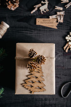 Handmade Christmas Gift On Dark Wooden Table