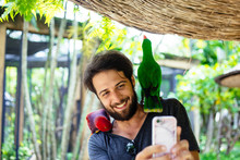 Man Playing With Tropical Birds