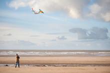 Mature Woman Having Fun Flying A Kite