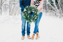 Couple Holding A Christmas Wreath