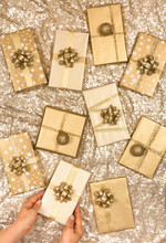 Woman Arranging Golden Themed Handmade Christmas Presents